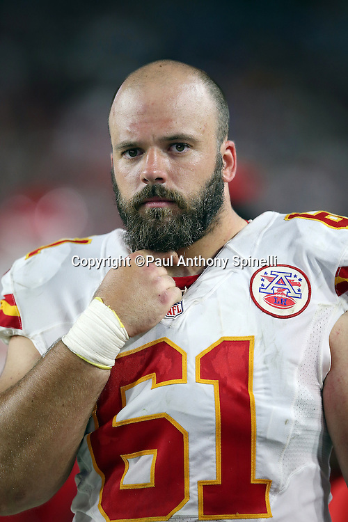 Kansas City Chiefs center Mitch Morse (61) looks on from the sideline during the 2015 NFL preseason football game against the Arizona Cardinals on Saturday, Aug. 15, 2015 in Glendale, Ariz. The Chiefs won the game 34-19. (©Paul Anthony Spinelli)