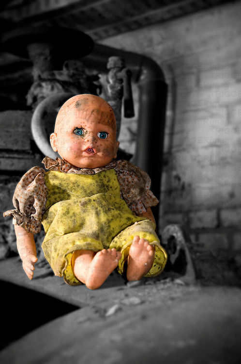 An old dirty plastic doll