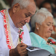Samoa's Head of State, Tui Atua Tupua Tamasese Efi studies the program for the 2013 American Samoa Flag Day Ceremonies, Veterans Stadium, Tafuna, Tutuila, American Samoa.  Photo by Barry Markowitz, 4/17/13, Courtesy Samoa Tuna Processors/Tri Marine Group
