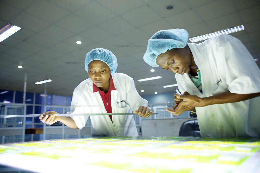 Quality-control workers at a factory producing plastic packaging and labelling for Nigerian and multinational companies. <br />