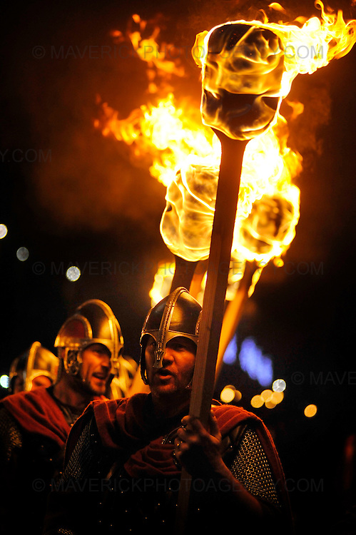 EDINBURGH, UK - 30th December 2010:  Edinburgh kicks off its Hogmanay celebrations with thousands of people joining in a torchlit procession creating a river of fire through the city from the historic Royal Mile to the fireworks finale on Calton Hill.  Pictured the Up Helly Aa vikings from Shetland lead the procession.  (Photograph: Callum Bennetts/MAVERICK)