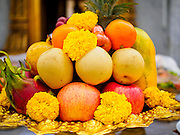 12 MARCH 2015 - BANGKOK, THAILAND:  Fruit left as an offering at the City Pillar Shrine in Bangkok. Bangkok's city pillar shrine (also known as San Lak Muang) is one of the most important city pillar shrines in Thailand. The shrine is in the heart of Bangkok, opposite the grand palace in the southeast corner of the Sanam Luang and close to the Ministry of Defence. The shrine was built after the establishment of the Rattanakosin Kingdom (Bangkok) to replace the old capital of the Thonburi Kingdom during the reign of King Rama I in 1782. It was intended to be the spiritual center for Thai citizens.     PHOTO BY JACK KURTZ