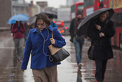 © licensed to London News Pictures. London, UK 14/12/2012. People walking under rain on London Bridge on 14/12/12. Photo credit: Tolga Akmen/LNP