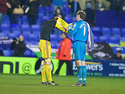 BIRKENHEAD, ENGLAND - Saturday, January 3, 2015: Tranmere Rovers' goalkeeper Owain Fon Williams and Swansea Cit's goalkeeper Gerhard Tremmel swap shirts after the FA Cup 3rd Round match at Prenton Park. (Pic by David Rawcliffe/Propaganda)