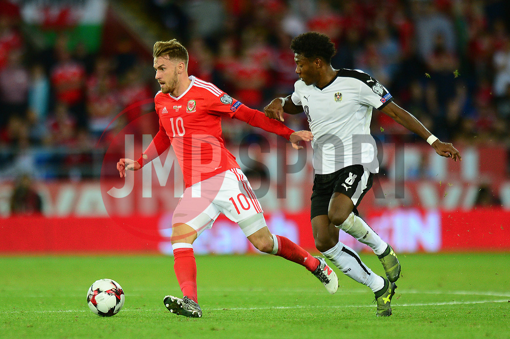 Aaron Ramsey of Wales is challenged by David Alaba of Austria - Mandatory by-line: Dougie Allward/JMP - 02/09/2017 - FOOTBALL - Cardiff City Stadium - Cardiff, Wales - Wales v Austria - FIFA World Cup Qualifier 2018
