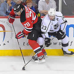 June 9, 2012: New Jersey Devils defenseman Anton Volchenkov (28) and Los Angeles Kings right wing Dustin Brown (23) battle for the puck along the boards during first period action in game 5 of the NHL Stanley Cup Final between the New Jersey Devils and the Los Angeles Kings at the Prudential Center in Newark, N.J.