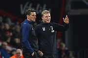 AFC Bournemouth manager Eddie Howe and assistant manager Jason Tindall discuss tactics during the Premier League match between Bournemouth and Huddersfield Town at the Vitality Stadium, Bournemouth, England on 4 December 2018.
