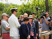 Secretary Hillary Clinton comforts Soon Chay, the mother of Army Staff Sergeant Kyu Hyuk Chay, a cryptologic linguist in the US Special Forces killed in Afghanistan, during Memorial Day Ceremonies at the Chappaqua Train Station on May 26, 2014. The Route 120 Bridge over the Saw Mill River Parkway has been named the Staff Sergeant Kyu Hyuk Chay Memorial Bridge. Behind Secretary Clinton are SSgt. Chay's father, Sam and brother, Kyu Tay Chay, who shared the same first name as his brother and who spoke about his brother's bravery and love for his country during the ceremonies.