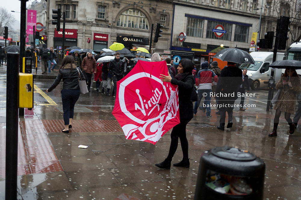 Storm Georgina swept across parts of Britain and in central London, lunchtime office workers were caught out by torrential rain and high winds, on 24th January 2018, in London, England. Pedestrians resorted to leaping across deep puddles at the junction of New Oxford Street and Kingsway at Holborn, the result of overflowing drains. First in a sequence of eight photos.