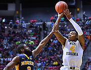 SAN DIEGO, CA - MARCH 16:  West Virginia Mountaineers guard Daxter Miles Jr. (4) shoots against Murray State Racers guard Jonathan Stark (2) during a first round game of the Men's NCAA Basketball Tournament at Viejas Arena in San Diego, California.  (Photo by Sam Wasson)