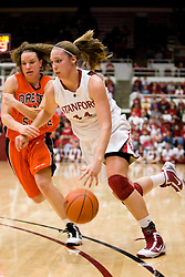 February 20, 2010; Stanford, CA, USA;  Stanford Cardinal forward Kayla Pedersen (14) dribbles past Oregon St. Beavers guard Talisa Rhea (11) during the first half at Maples Pavilion. Stanford defeated Oregon State 82-48.
