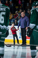 KELOWNA, CANADA - DECEMBER 30: Wayne McDermott and his grandson stand on the ice for a special presentation between the Kelowna Rockets and the Everett Silvertips on December 30, 2015 at Prospera Place in Kelowna, British Columbia, Canada.  (Photo by Marissa Baecker/Shoot the Breeze)  *** Local Caption *** Wayne McDermott;
