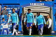 Loic Remy of Chelsea (centre) walks out onto the pitch to warm up with Mohamed Salah of Chelsea (left) and Kurt Zouma of Chelsea (right) before the Barclays Premier League match at Stamford Bridge, London<br /> Picture by David Horn/Focus Images Ltd +44 7545 970036<br /> 13/09/2014