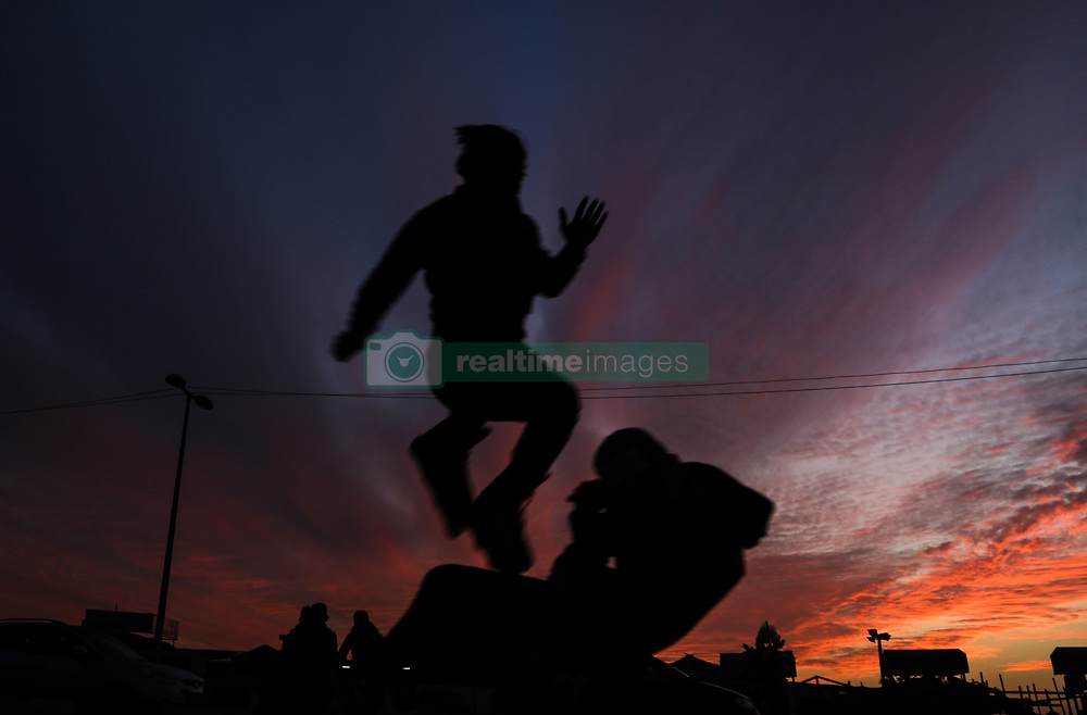January 3, 2018 - Gaza, Gaza Strip, Gaza - Palestinian youngsters enjoy the sunset at the sea, off the coast of Gaza Strip. (Credit Image: © Nidal Alwaheidi/Pacific Press via ZUMA Wire)