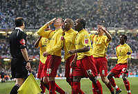 Photo: Rich Eaton.<br /> <br /> Leeds United v Watford. Coca Cola Championship. Play off Final. 21/05/2006.<br /> <br /> Watford players celebrate their 3rd goal scored from the penalty spot by Darius Henderson, with arm raised to his face