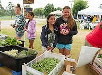 Brianna Dargin, Ari Braccio, Dantia Braccio and Emma Dargin check out the local produce from Winnipesaukee Woods Farm at Gilford's Farmers Market on Saturday morning.   (Karen Bobotas/for the Laconia Daily Sun)