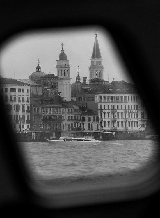 Black and white photograph of towers in Venice.
