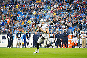 NASHVILLE, TN - NOVEMBER 29:  Derek Carr #4 of the Oakland Raiders rolls out to pass during a game against the Tennessee Titans at Nissan Stadium on November 29, 2015 in Nashville, Tennessee.  The Raiders defeated the Titans 24-21.  (Photo by Wesley Hitt/Getty Images) *** Local Caption *** Derek Carr