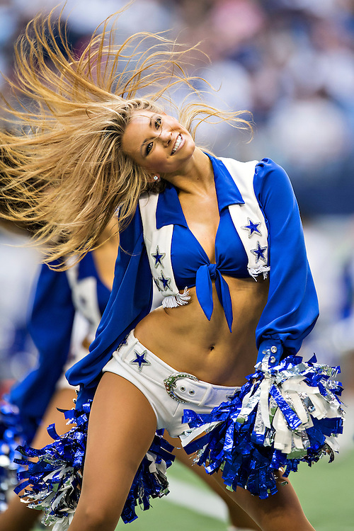 ARLINGTON, TX - NOVEMBER 3:  Cheerleader of the Dallas Cowboys performs during a game against the Minnesota Vikings at AT&T Stadium on November 3, 2013 in Arlington, Texas.  The Cowboys defeated the Vikings 27-23.  (Photo by Wesley Hitt/Getty Images) *** Local Caption ***