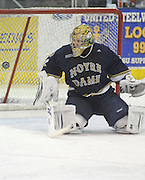 Notre Dame goaltender Mike Johnson watches a blocked shot bounce away during Friday's game against Lake Superior State in Sault Ste. Marie.