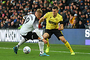Derby County forward Martyn Waghorn (9) challenges Millwall defender Murray Wallace (3) during the EFL Sky Bet Championship match between Derby County and Millwall at the Pride Park, Derby, England on 14 December 2019.