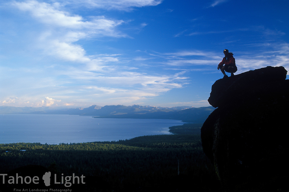 Hiker enjoys a view of Lake Tahoe from the Tahoe Rim Trail near Watson lake on the North Shore.