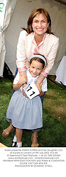 Radio presenter EMMA FORBES and her daughter LILLY, at a party in London on 8th July 2003.PLG 89