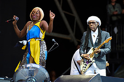 Nile Rodgers and Kimberly Davis performing with Chic on the Pyramid Stage during the Glastonbury Festival at Worthy Farm in Pilton, Somerset. Picture date: Sunday June 25th 2017. Photo credit should read: Matt Crossick/ EMPICS Entertainment.