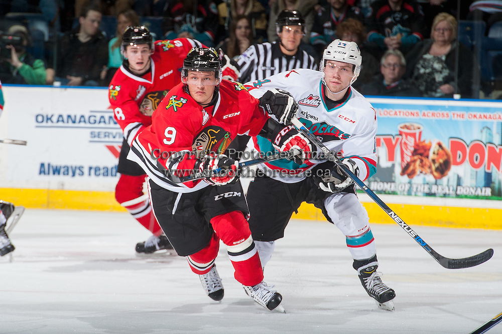 KELOWNA, CANADA - JANUARY 29: Rihards Bukarts #9 of Portland Winterhawks checks Rourke Chartier #14 of Kelowna Rockets on January 29, 2016 at Prospera Place in Kelowna, British Columbia, Canada.  (Photo by Marissa Baecker/Shoot the Breeze)  *** Local Caption *** Rihards Bukarts; Rourke Chartier;