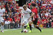 Michael Carrick All-Stars Damien Duff and Manchester United 08 XI Ji-sung Park tackle during the Michael Carrick Testimonial Match between Manchester United 2008 XI and Michael Carrick All-Star XI at Old Trafford, Manchester, England on 4 June 2017. Photo by Phil Duncan.