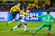 Borussia Dortmund midfielder Christian Pulisic (22) tackles Tottenham Hotspur midfielder Erik Lamela (11) during the Champions League round of 16, leg 2 of 2 match between Borussia Dortmund and Tottenham Hotspur at Signal Iduna Park, Dortmund, Germany on 5 March 2019.
