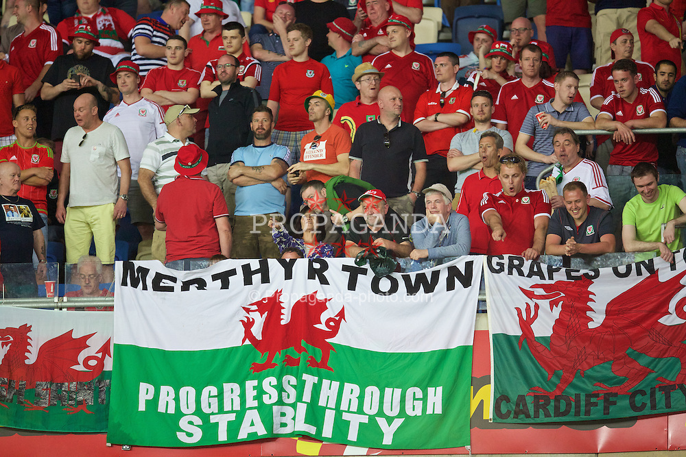 HAIFA, ISRAEL - Saturday, March 28, 2015: Wales' supporters' flag 'Merthyr Town Progress Through Stability' before the UEFA Euro 2016 qualifying Group B match against Israel at the Sammy Ofer Stadium. (Pic by David Rawcliffe/Propaganda)