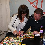 London, UK, 8th August 2017. Shaun Ryder signing Black Grape's new album, Pop Voodoo, for a fan.