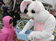 MacKenzie Anderson, 7, from Dayton gets a treat from the Easter bunny before an Easter egg hunt sponsored by the Montgomery County Sheriff's Office Police Athletic League, Saturday morning..