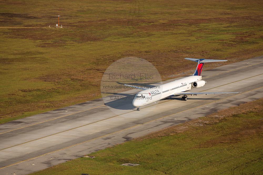 Aerial view of Delta Airlines MD-88 aircraft taxing at Charleston International Airport Charleston, South Carolina.