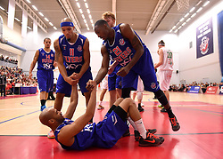 Cardell McFarland of Bristol Flyers is helped to his feet by Tyrone Lee of Bristol Flyers and Greg Streete of Bristol Flyers   - Mandatory byline: Joe Meredith/JMP - 11/12/2015 - Basketball - SGS Wise Campus - Bristol, England - Bristol Flyers v Plymouth Raiders - British Basketball League