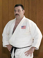 Vince Ashcraft, from Piqua watches a judo class in the Miami County YMCA, Thursday, May 31st.