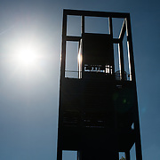 The sun silhouettes the tower at the Netherlands Carillon next to Arlington National Cemetery and the Iwo Jima Memorial. First donated in 1954, the Carillon was moved to its current location in 1960. It was a gift of the Netherlands to the United States in thanks for US aid during World War II.