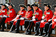 Chelsea Pensioners war veterans in traditional red and black uniforms with tricorn hats at the Royal Hospital Chelsea, London