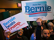 """31 DECEMBER 2019 - DES MOINES, IOWA: Bernie Sanders supporters during Sen. Bernie Sanders' """"Big New Year's Bash,"""" a combination campaign rally/New Years Eve Party at the Marriott Hotel Downtown in Des Moines. Sen. Sanders is in Iowa campaigning to be the Democratic presidential nominee in 2020. Iowa hosts the first selection event of the presidential election cycle. The Iowa Caucuses are Feb. 3, 2020.       PHOTO BY JACK KURTZ"""
