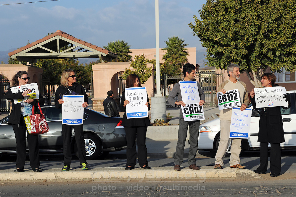 Members of the Alisal Teachers Association and the California School Employees Association picket outside Bardin Elementary School before a scheduled meeting of the Alisal School Board on Wednesday, October 9th in Salinas. Teachers were protesting the cancellation of school board meetings, and the lack of adequate textbooks and classroom materials for the 2013/2014 school year.