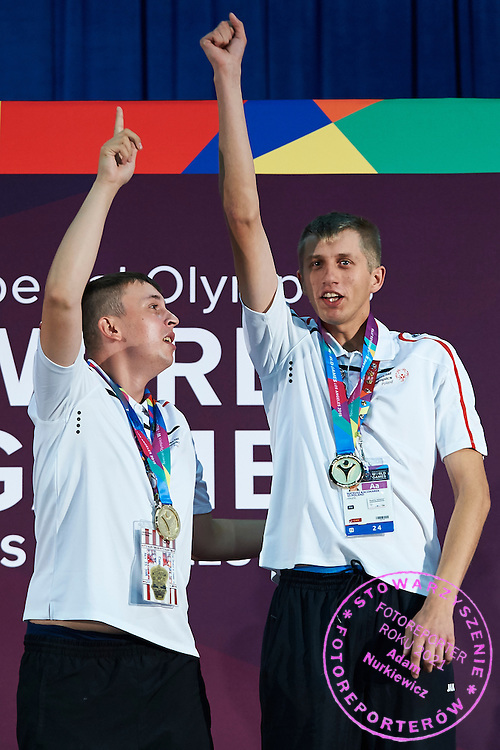 (L) SO Poland athlete Patryk Jaszcz and (R) SO Poland athlete Mateusz Kaczmarek while medal ceremony after bowling competition during fifth day of the Special Olympics World Games Los Angeles 2015 on July 29, 2015 at Los Angeles Convention Centre in Los Angeles, USA.<br /> <br /> USA, Los Angeles, July 29, 2015<br /> <br /> Picture also available in RAW (NEF) or TIFF format on special request.<br /> <br /> For editorial use only. Any commercial or promotional use requires permission.<br /> <br /> Adam Nurkiewicz declares that he has no rights to the image of people at the photographs of his authorship.<br /> <br /> Mandatory credit:<br /> Photo by &copy; Adam Nurkiewicz / Mediasport