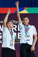 (L) SO Poland athlete Patryk Jaszcz and (R) SO Poland athlete Mateusz Kaczmarek while medal ceremony after bowling competition during fifth day of the Special Olympics World Games Los Angeles 2015 on July 29, 2015 at Los Angeles Convention Centre in Los Angeles, USA.<br /> <br /> USA, Los Angeles, July 29, 2015<br /> <br /> Picture also available in RAW (NEF) or TIFF format on special request.<br /> <br /> For editorial use only. Any commercial or promotional use requires permission.<br /> <br /> Adam Nurkiewicz declares that he has no rights to the image of people at the photographs of his authorship.<br /> <br /> Mandatory credit:<br /> Photo by © Adam Nurkiewicz / Mediasport