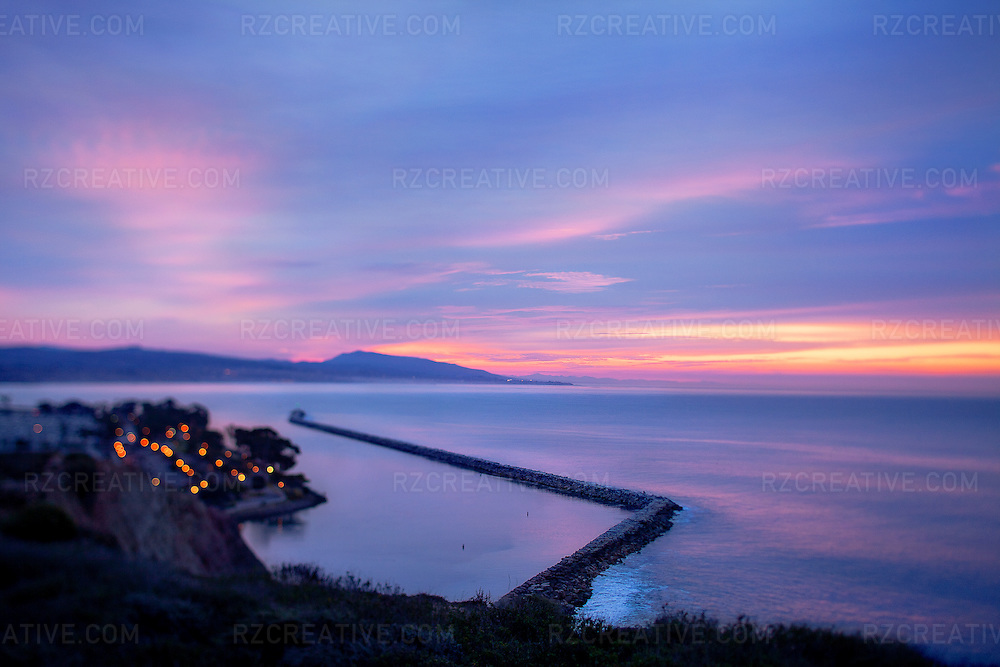 Sunrise on a cloudy winter morning in Orange County California overlooking Dana Point Harbor.