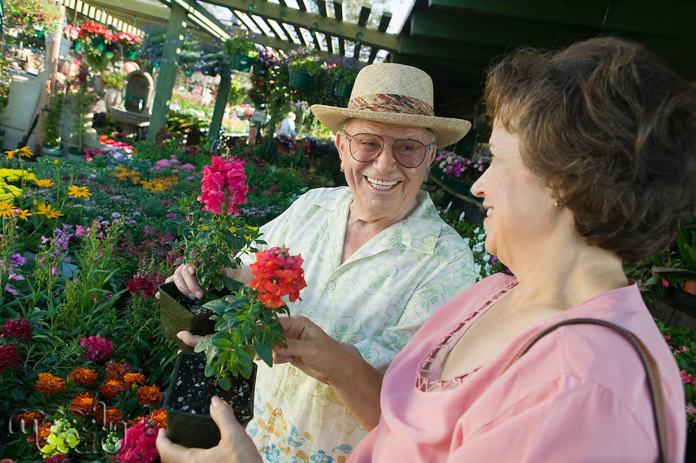 Senior Couple Shopping for flowers at plant nursery