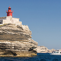 "Photo of a yacht approaching the lighthouse of ""Madonetta""."