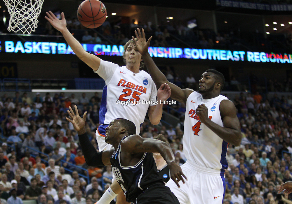 Mar 26, 2011; New Orleans, LA; Butler Bulldogs guard Shelvin Mack (1) his his shot blocked by Florida Gators forward Chandler Parsons (25) during the first half of the semifinals of the southeast regional of the 2011 NCAA men's basketball tournament at New Orleans Arena.   Mandatory Credit: Derick E. Hingle