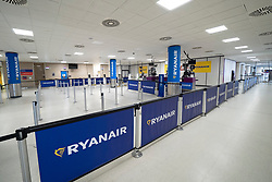 Edinburgh, Scotland, UK. 27 March, 2020. Interior views of a deserted Edinburgh Airport during the coronavirus pandemic. With very few flights during the current Covid-19 crisis passengers are scarce in the terminal building. Nobody at a closed Ryanair check-in area. Iain Masterton/Alamy Live News