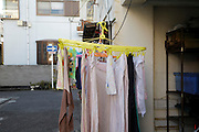 clothing drying outside the garage in a residential neighborhood