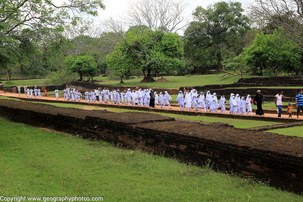 Large school group of children in the palace water gardens, Sigiriya, Central Province, Sri Lanka, Asia
